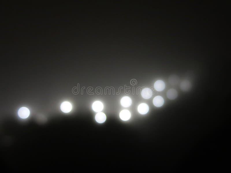 Abstracte lichten in de mist Ray van helder wit licht royalty-vrije stock fotografie