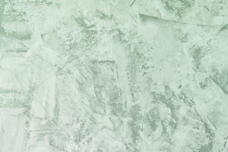 Abstracte lichtgroene achtergrond Textuur van ongelijke gepleisterde muur Stopverf met vlekken en ruwheid De basis voor stock foto