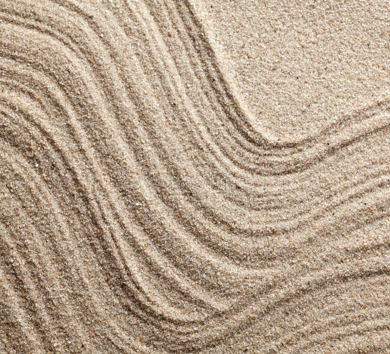 Abstracte lijnen op zand stock afbeeldingen