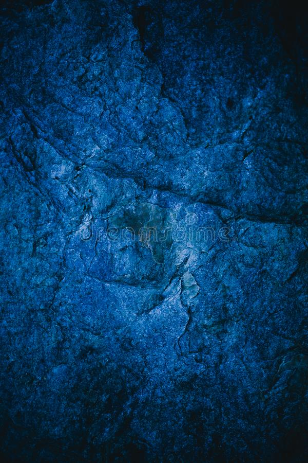 Abstracte marineblauwe textuur en achtergrond voor ontwerp Blauwe uitstekende achtergrond Ruwe blauwe die textuur met steen wordt stock foto's