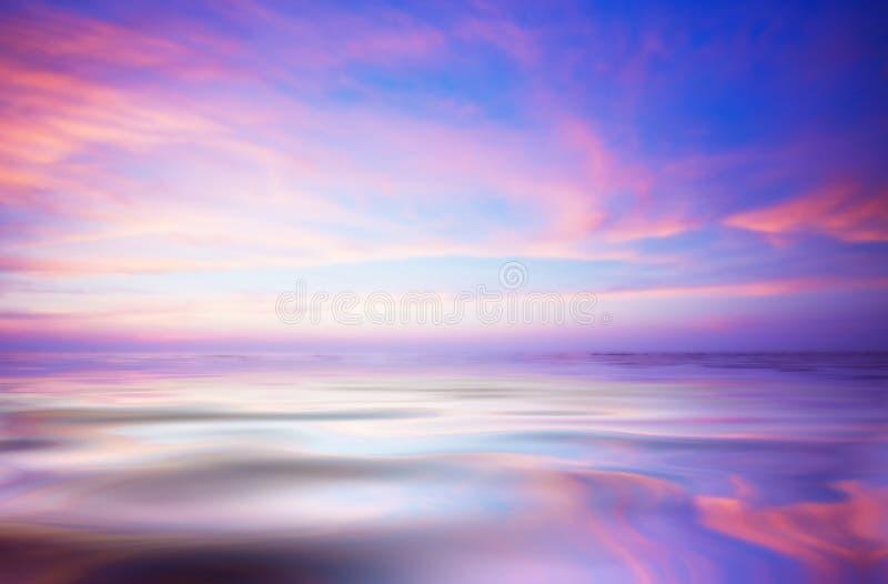 Abstracte oceaan en zonsondergang stock foto