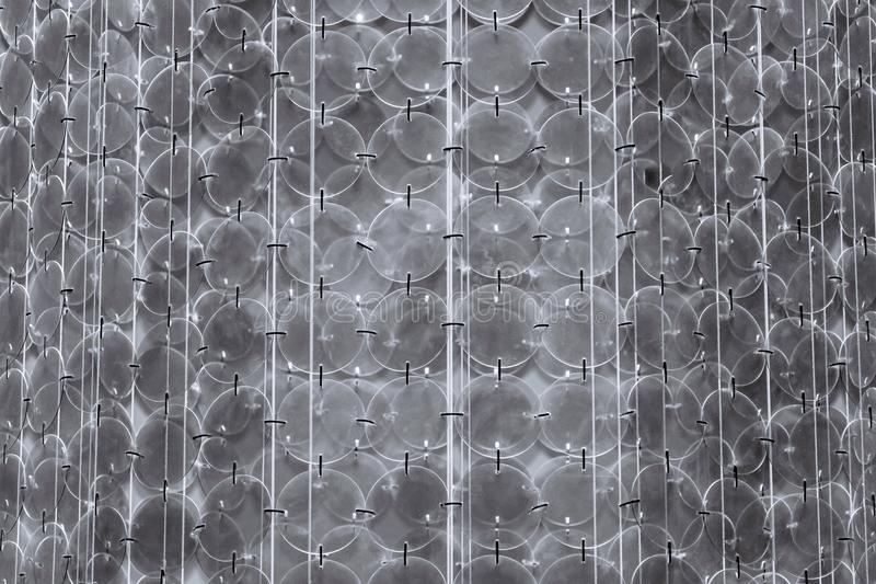 Abstracte ondoorzichtige geweven achtergrond van een kroonluchter of een kandelaber stock fotografie