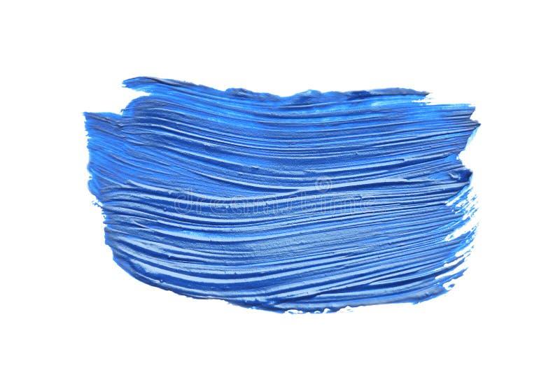 Abstracte penseelstreek van blauwe die verf op wit wordt geïsoleerd stock fotografie
