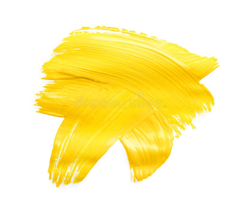 Abstracte penseelstreek van gele die verf op wit wordt geïsoleerd royalty-vrije stock foto's