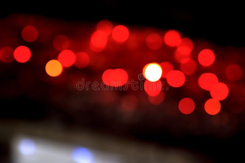 Abstracte Rode onduidelijk beeld bokeh achtergrond stock afbeelding