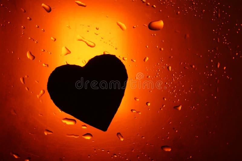 Abstracte silho van het van de achtergrond waterdaling rode oranje lichte vlekhart stock afbeeldingen