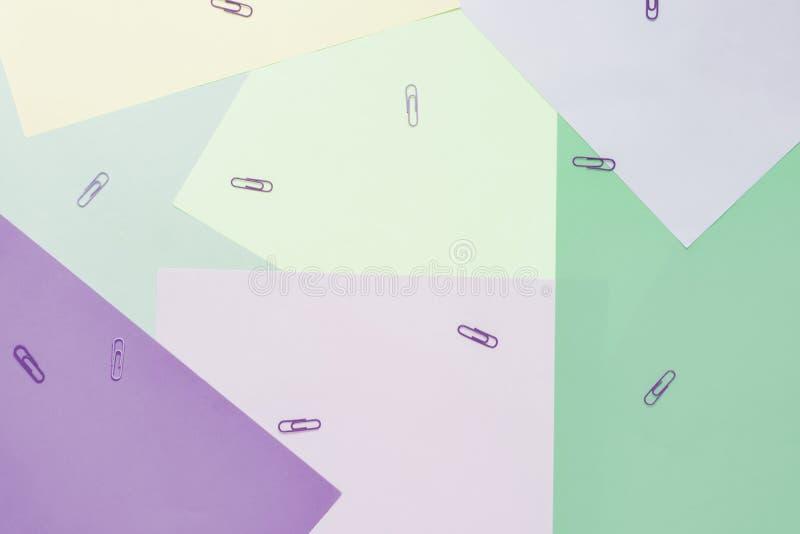 Abstracte verschillende multicolored pastelkleurachtergronden met klemmen en plaats voor tekst Hoogste mening royalty-vrije stock afbeelding
