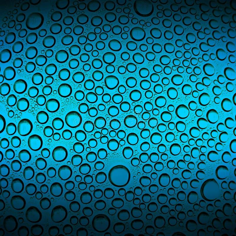 Abstracte waterdalingen op blauwe achtergrond stock afbeeldingen
