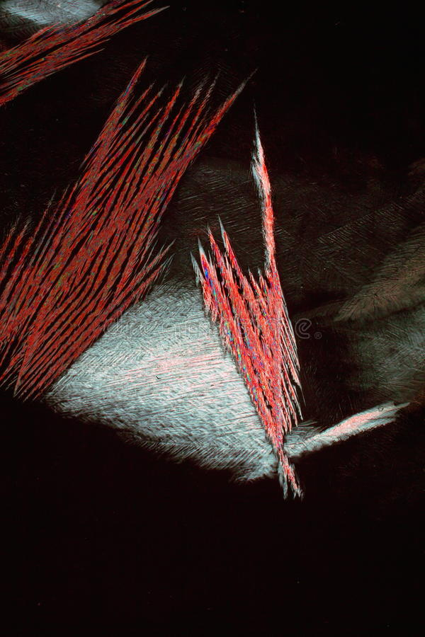 Abstracted Ice Needles. Closeup of melting ice on black background. whose needles have been abstracted to red color Much room for text royalty free stock photos