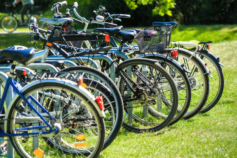 Abstracted image with intentionally low depth of field from a group of bicycles parked on the lawn of a public park. Germany royalty free stock image