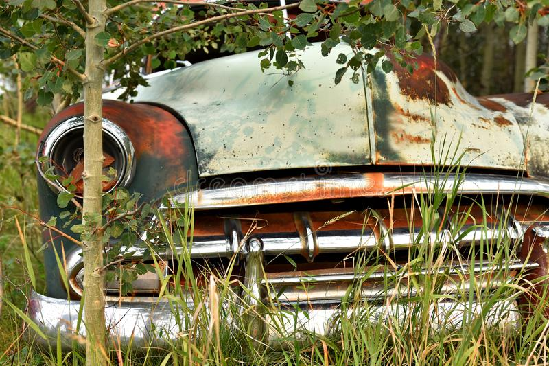 Old Rusted Car Wreckage. An abstracted image of the rusted wreckage of an old abandoned car stock photos