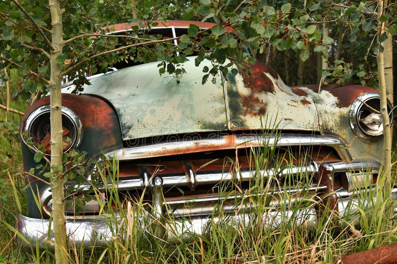 Old Rusted Car Wreckage. An abstracted image of the rusted wreckage of an old abandoned car royalty free stock photos