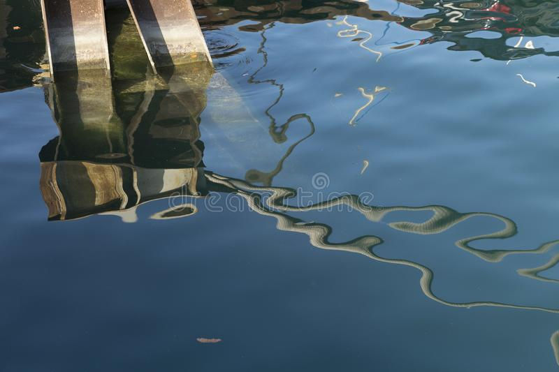 Abstracted Summer Waters in Chicago 4. Abstract of water and pier beams in the Chicago marina. Consists of three piers and the water reflection design royalty free stock photo