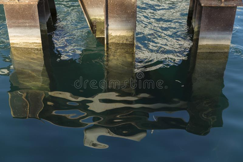 Abstracted Summer Waters in Chicago 3. Abstract of water and pier beams in the Chicago marina. Consists of three piers and the water reflection design stock photos