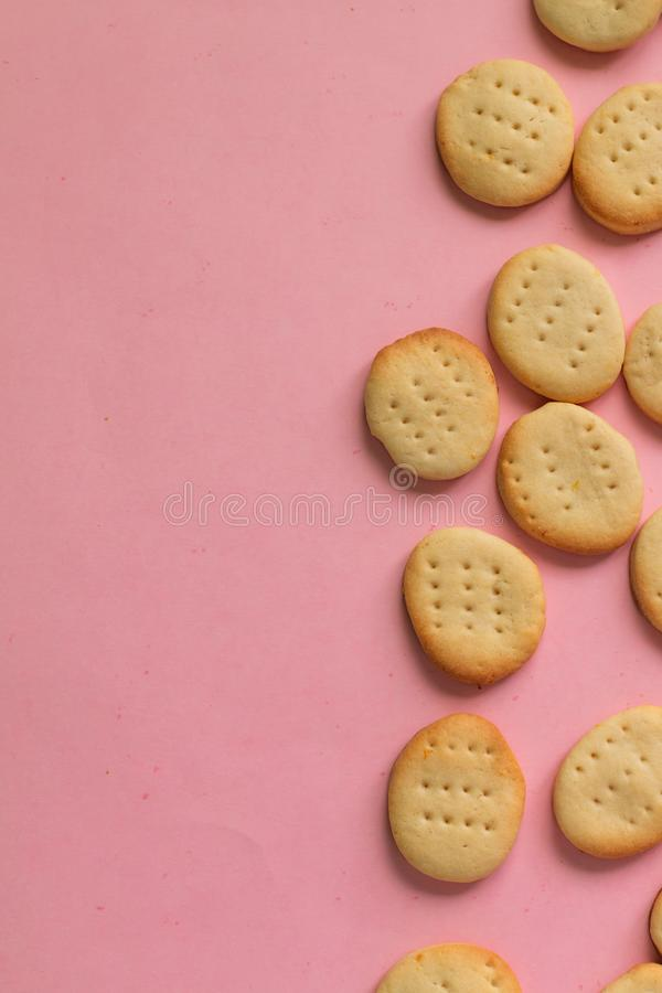 Abstracted trendy seamless baked food pattern from homemade cookies on pink background with space for text. Abstracted trendy seamless baked food pattern from stock images