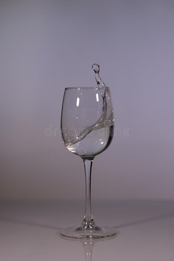 The water in the glass. Glass of water. Glass of water on a dark background. royalty free stock photography