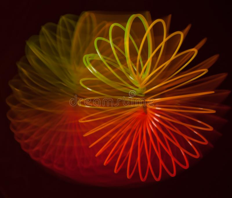 Abstraction of a rainbow spiral on a black background. Abstraction of a rainbow spiral in motion on a black background royalty free stock photography