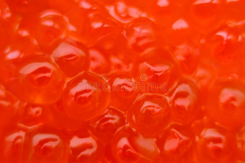 Abstraction. Salmon caviar. Bright background. Fish roe. Macro. Bright background. Fish roe. Macro royalty free stock images