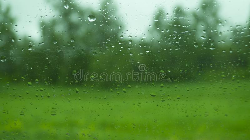 Abstraction, view through the glass of the car on the outside world in rainy weather. Abstraction, the view through the glass of the car on the outside world in stock image