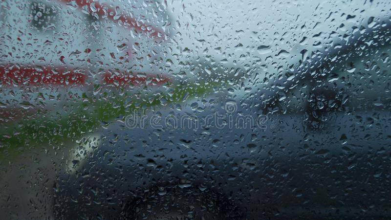 Abstraction, view through the glass of the car on the outside world in rainy weather. Abstraction, the view through the glass of the car on the outside world in royalty free stock images