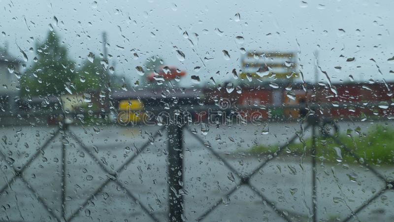 Abstraction, view through the glass of the car on the outside world in rainy weather. Abstraction, the view through the glass of the car on the outside world in stock photo