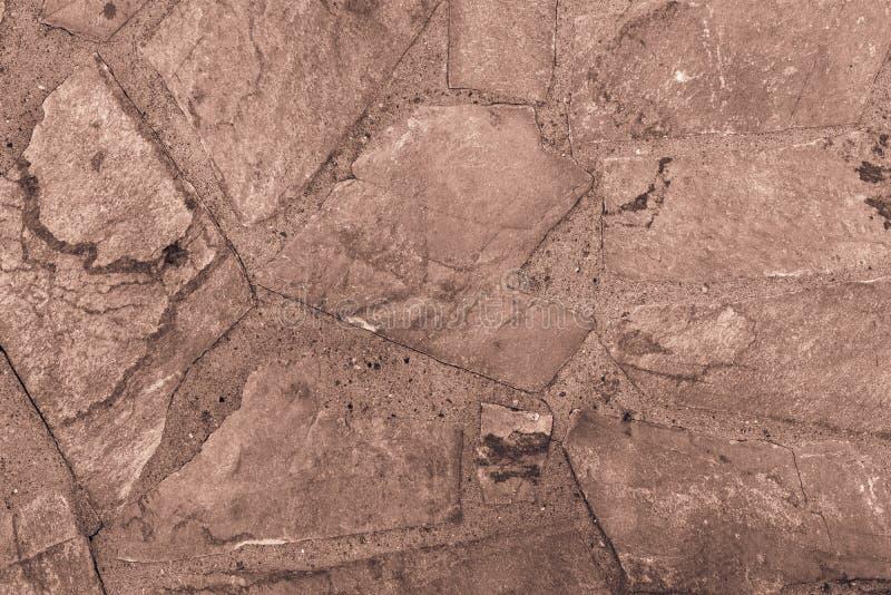 Abstraia o fundo textured de uma cor de pedra do marrom da telha fotos de stock royalty free