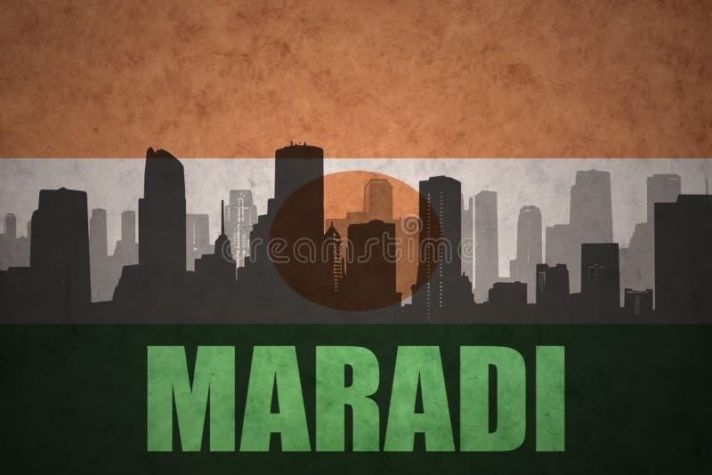Abstrakcjonistyczna sylwetka miasto z tekstem Maradi przy rocznika Niger flaga zdjęcie stock