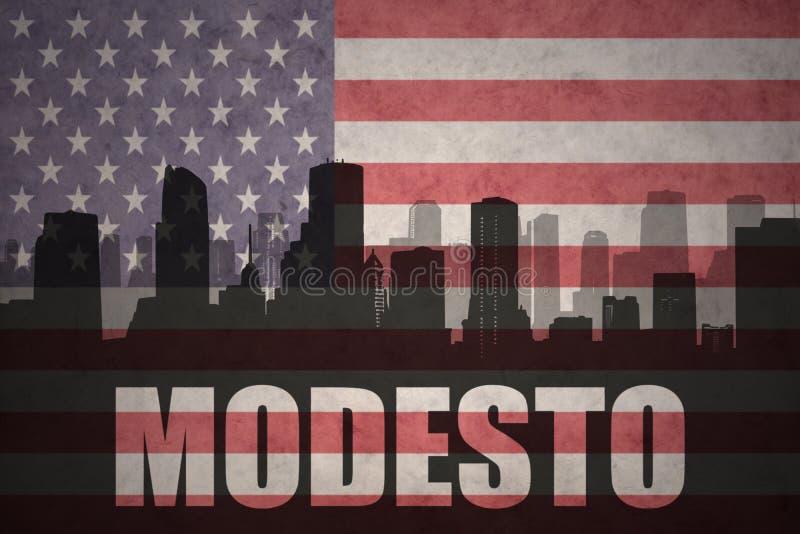 Abstrakcjonistyczna sylwetka miasto z tekstem Modesto przy rocznik flaga amerykańską obraz stock