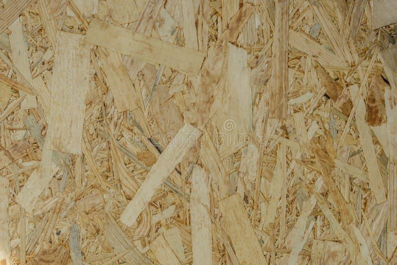 Abstrakcjonistyczna tło tekstura Drewniani układy scaleni felted brown kolor OSB zdjęcie stock