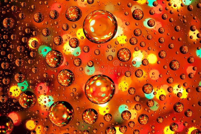 Abstrakcjonistyczne tło tekstury krople woda i sztuka zaświecają na glas zdjęcia royalty free