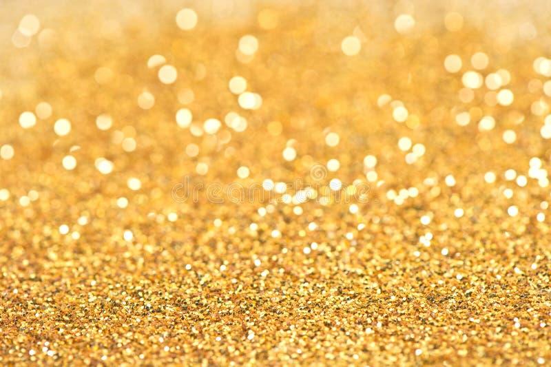 abstrakcjonistycznego tła złoci ligths błyszczący zdjęcie stock