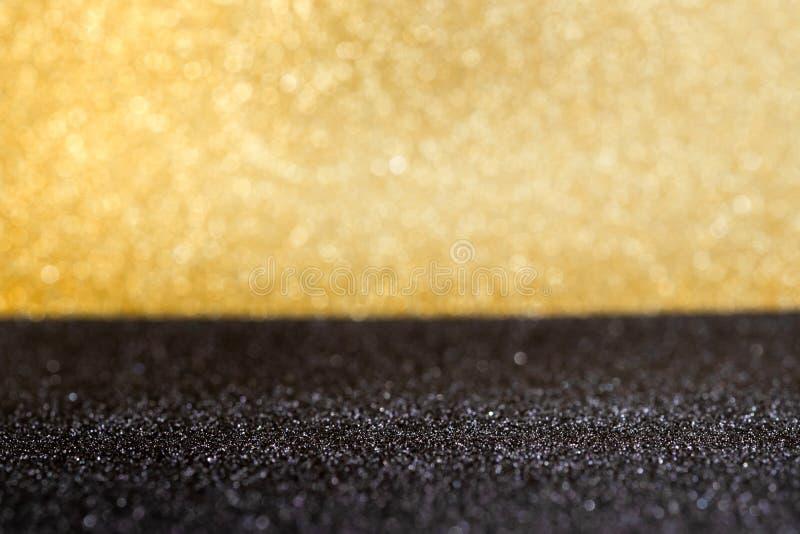 Abstrakcjonistycznego złota i czarnego iskrzastego bokeh backgroun ścienny i podłogowy obrazy stock