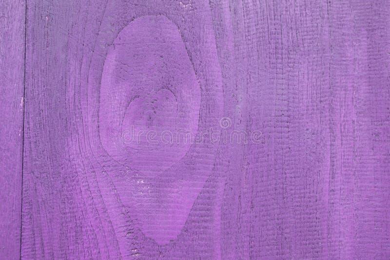 Abstrakcjonistycznego zbliżenia tekstury purpurowy drewniany tło obraz stock