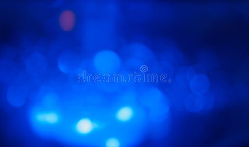 Abstrakcjonistyczni błękitni, biali bokeh okręgi, zdjęcia stock