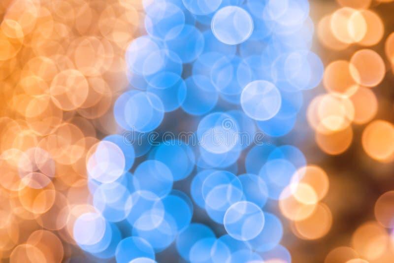 Abstrakcjonistyczny świąteczny magiczny błyszczący dyskoteki tło błękitny, złocisty żółty kolor z bokeh skutkiem dla i obrazy stock