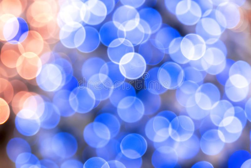 Abstrakcjonistyczny świąteczny magiczny dyskoteki tło błękit i brzoskwinia kolor z bokeh skutkiem dla gratulacje lub plakata dla  obraz royalty free