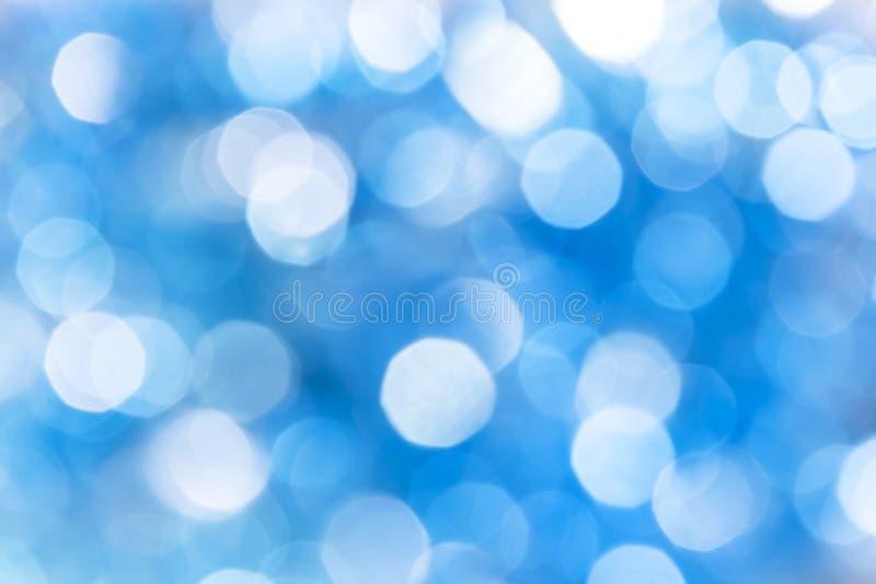 Abstrakcjonistyczny świąteczny jaskrawy tło z błękitnym bokeh skutkiem z c obrazy stock