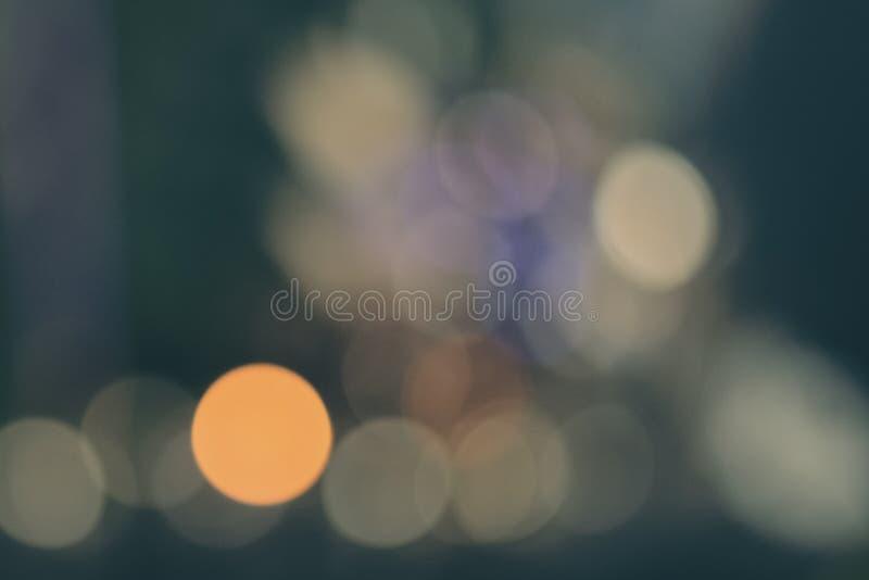 Abstrakcjonistyczny błękitnej zieleni bokeh tło z miękkimi ostrość bożonarodzeniowymi światłami obraz royalty free