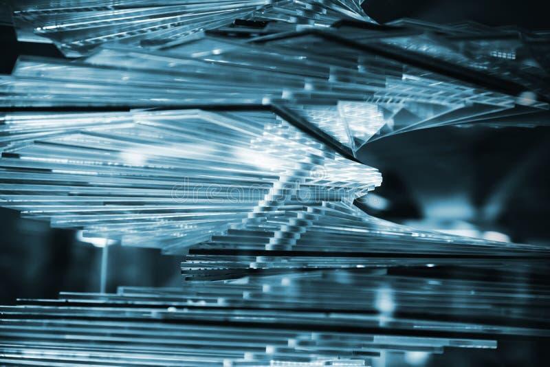 Abstrakcjonistyczny błękitny tło z stertą szkło zdjęcie royalty free