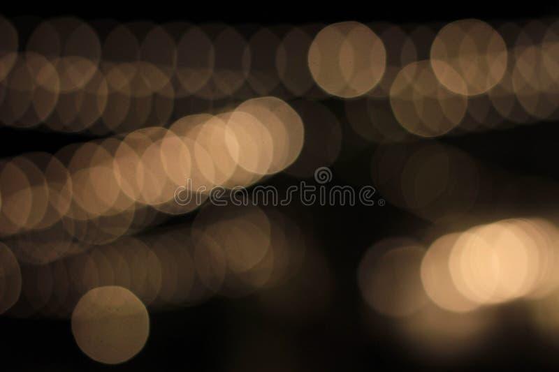 Abstrakcjonistyczny bokeh prowadził lightings zamazujących na czarnym tle obrazy royalty free