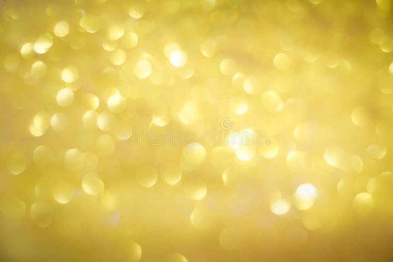 Abstrakcjonistyczny bokeh złota błyskotliwość zdjęcia royalty free