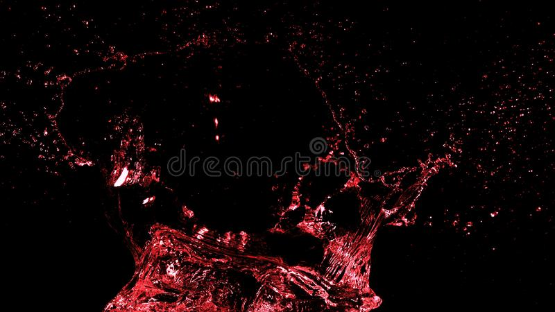 Abstrakcjonistyczny czerwonego wina pluśnięcia kształt na czarnym tle obraz royalty free