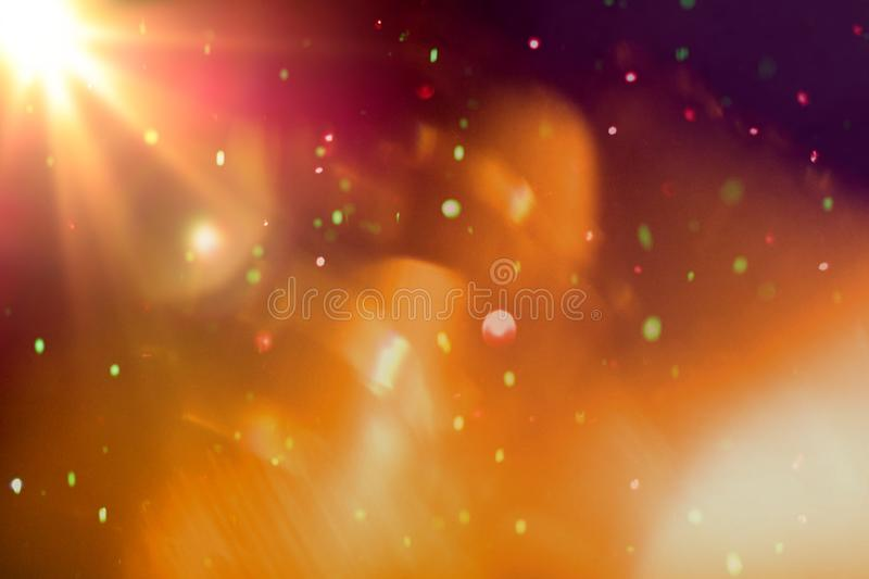 Abstrakcjonistyczny kolorowy bokeh światło z lekkim racą na czarnym tle obrazy royalty free