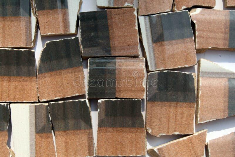 Abstrakcjonistyczny kolorowy tło łamane podłogowe płytki odizolowywać zdjęcia stock