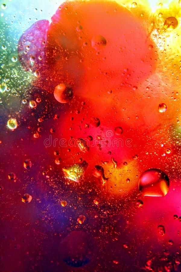 Abstrakcjonistyczny kolorowy tło olej w wody powierzchni pianie mydło z bąbla strzału makro- zakończeniem fotografia royalty free