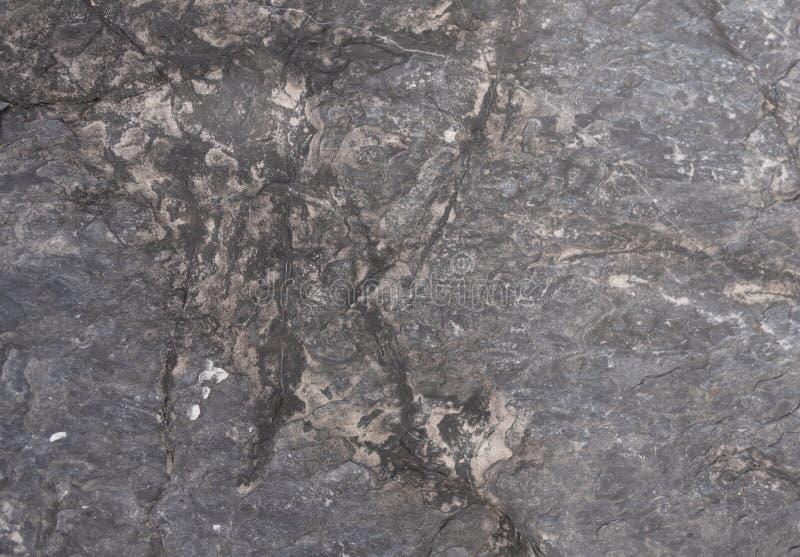Abstrakcjonistyczny tło i tekstury zmrok - szarość kamień zdjęcia stock