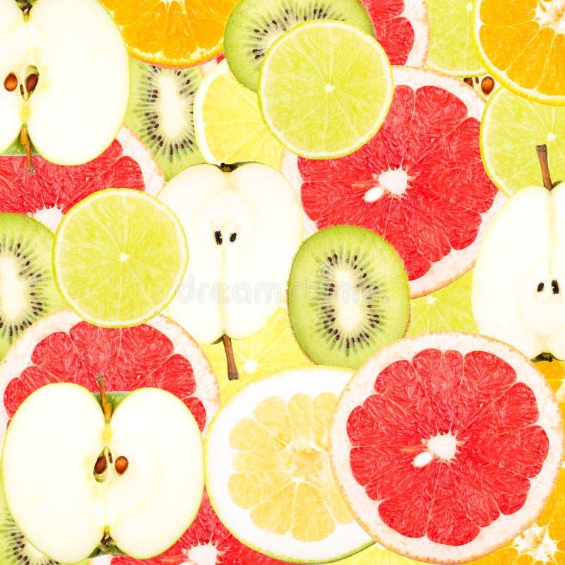 Abstrakcjonistyczny tło z plasterkami świeże owoc Bezszwowy wzór dla projekta obraz stock