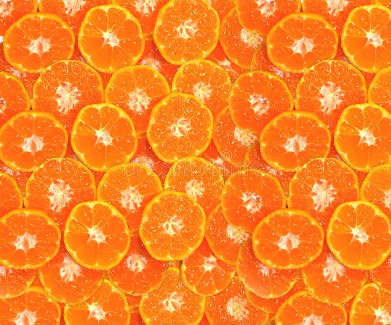 Abstrakcjonistyczny tło z pomarańcze pokrajać tło zdjęcie stock