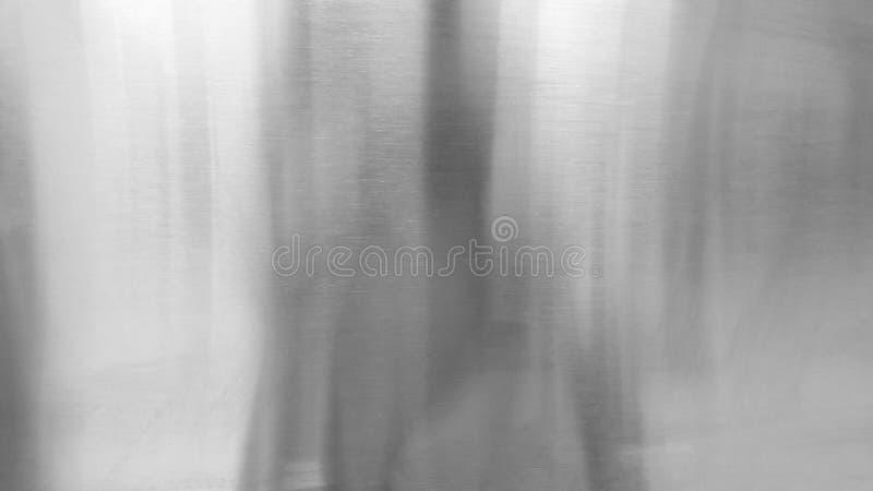Abstrakcjonistyczny tekstury t?o, lekki ja?nienie na szorstkiej szarej metal ?cianie obrazy stock