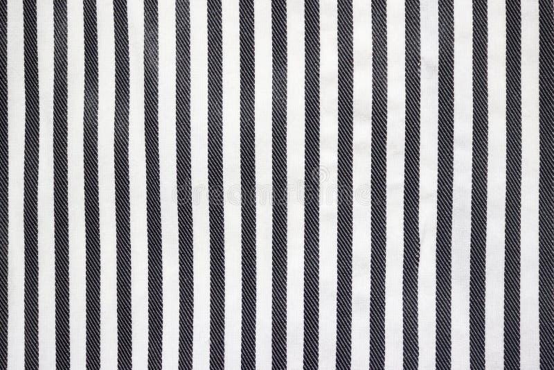 Abstrakcjonistyczny tkaniny tło z czarny i biały lampasami zdjęcia royalty free